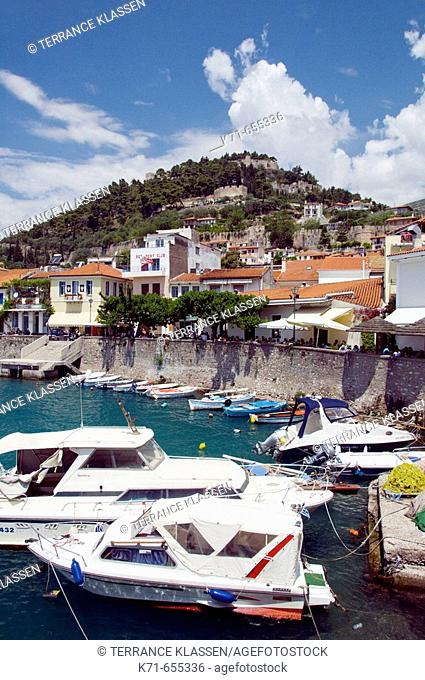 Circular walled harbour with colorful fishing boats at Nafpaktos, Greece