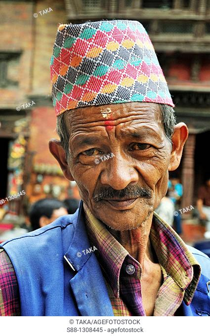 The man with traditional Nepali hat