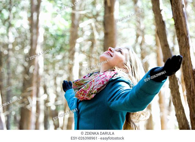 blond casual woman happy outdoors in the woods