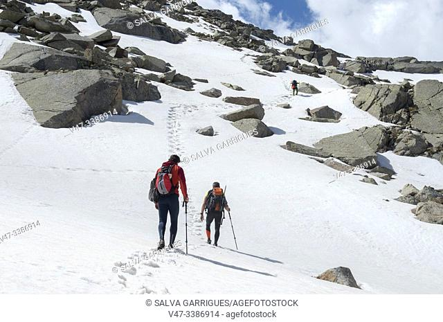 Mountaineers ascending to the peak of Vallibierna, Huesca, Aragon, Spain