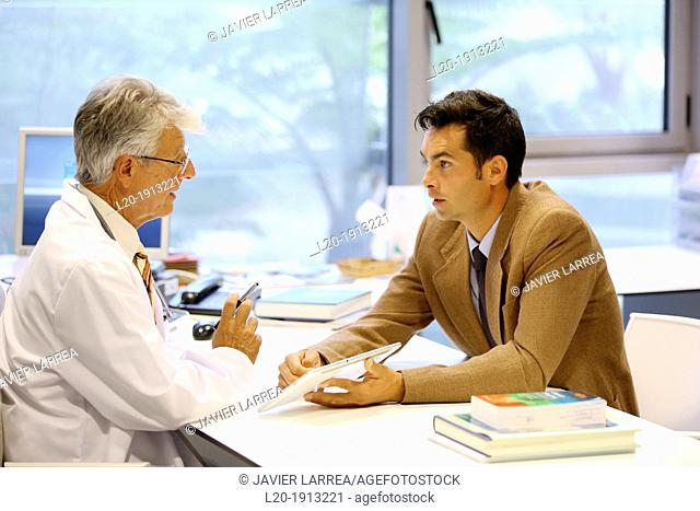 Doctor attending to seller, Tablet, Consulting room, Onkologikoa Hospital, Oncology Institute, Case Center for prevention, diagnosis and treatment of cancer