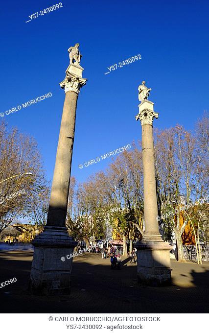 Roman columns with statues of Hercules and Julius Caesar, La Alameda, Seville, Andalusia, Spain