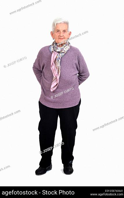 front view of a full portrait of a senior woman hands on back on white background