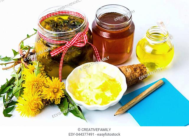 Dandelion homemade products and flowers with a notebook