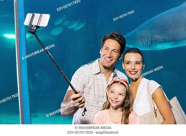 Happy family using selfie stick