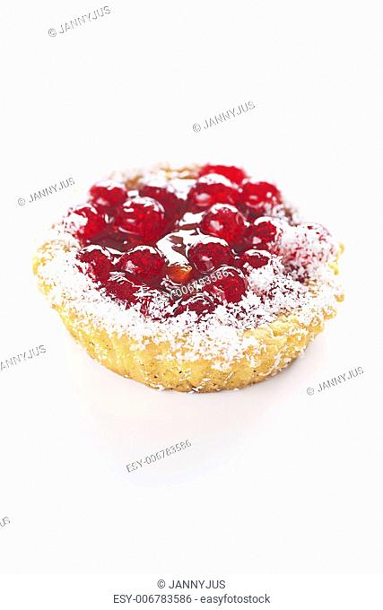 beautiful cake with berries on a white background