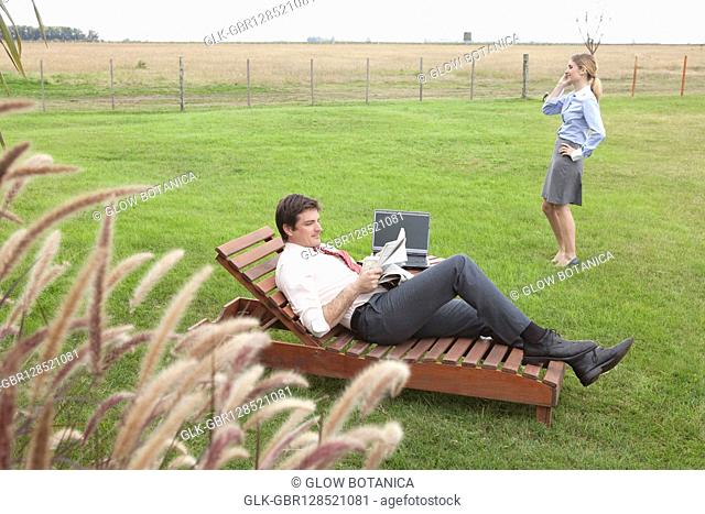 Business people in a lawn