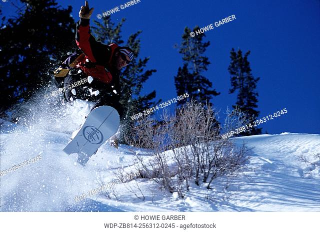 Brett Kobernick snowboarder gets big air on his Voile Split Decision. Wasatch Cache National Forest, Utah