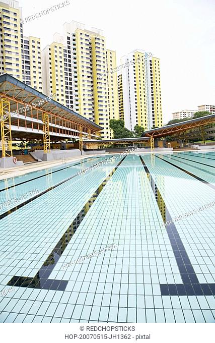 Swimming pool in front of buildings, Clementi Swimming Complex, Clementi, Singapore