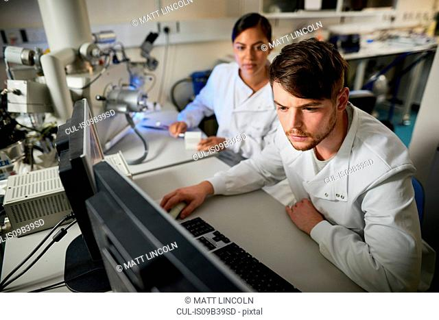 Scientist in laboratory using computer