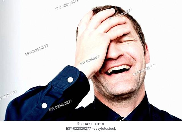 Close up portrait of hard laughing man
