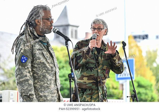 """Vietnam veterans Darnell Stephen Summers (L) and Dave Blalock rehearse for the """"""""Born with the USA"""""""" festival at the grounds of the former US hospital in..."""
