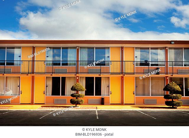 Parking lot, doors and windows of motel