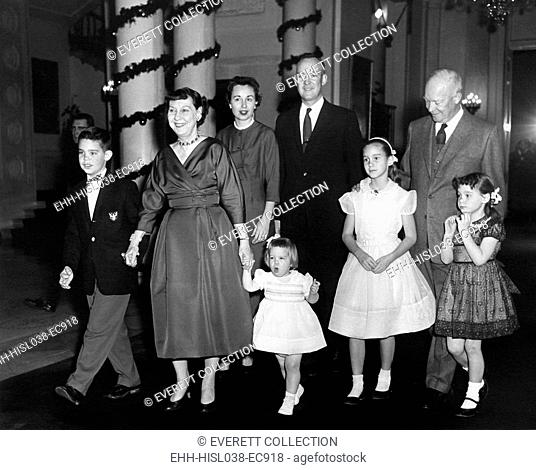 Eisenhower family Christmas at the White House. L-R: David, the First Lady, Barbara, Mary Jean, John, Barbara Ann, the President, and Susan. Ca. 1958