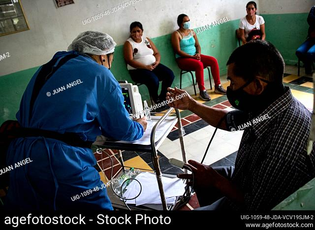 A nurse takes vitals of a man as people in San Jose de la Montana - Norte de Santander Colombia - get rapid tests and the Jansen Johnson & Johnson novel...