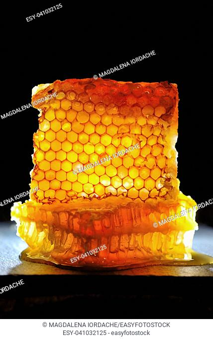 Sweet Honeycomb on black background