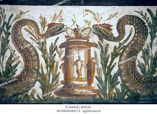 In the lower part are two snakes crawling towards a cista mystica sacred chest, or basket, used to house snakes