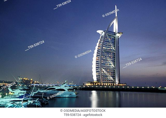 Night view of Burj al-Arab luxury hotel, Dubai. UAE