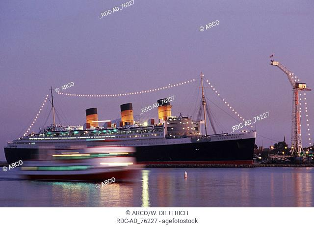 Queen Mary hotel and museum in the evening harbour of Long Beach Los Angeles California USA