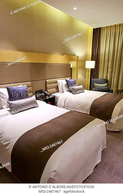 A luxury hotel room with two beds