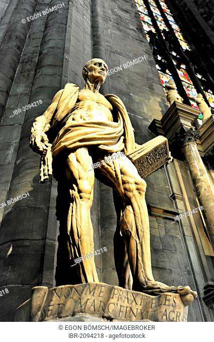 Sculpture of St. Bartholomew in front of Milan Cathedral, Duomo di Milano, construction begin in 1386, completion in 1858, Milan, Milano, Lombardy, Italy
