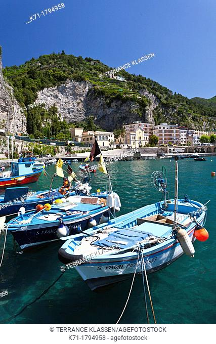 Fishing boats in the picturesque harbor of Maiori, Italy