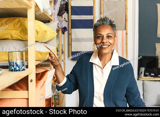 African American entrepreneur facing the camera in her home decor shop