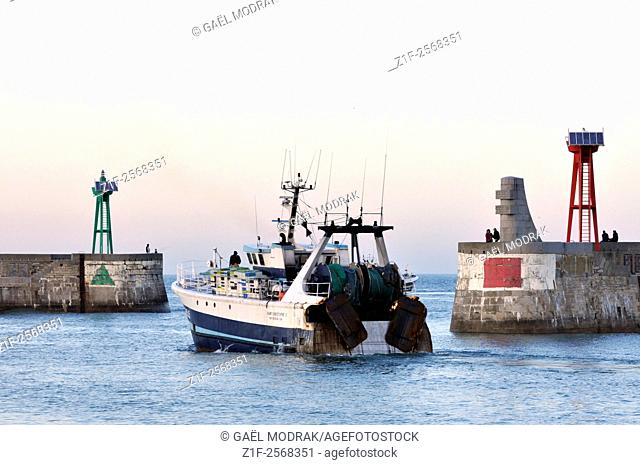 A trawler leaving Port-en-Bessin for a fishing session in Normandy, France