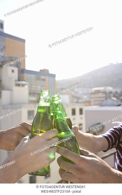 Friends having a drink on a rooftop terrace
