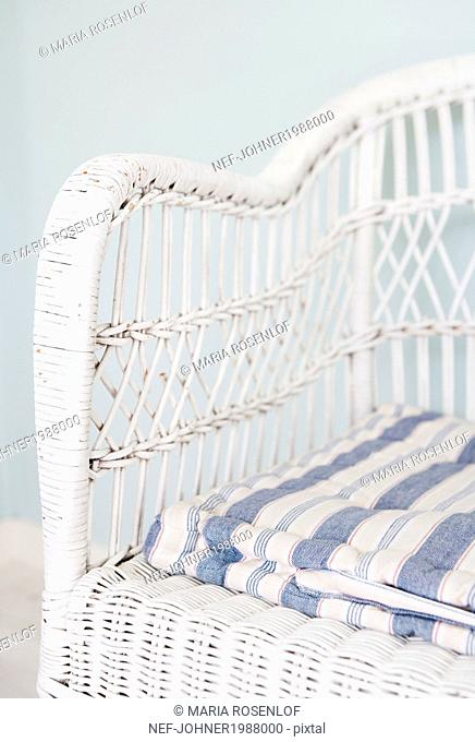 Close-up of white wicker chair