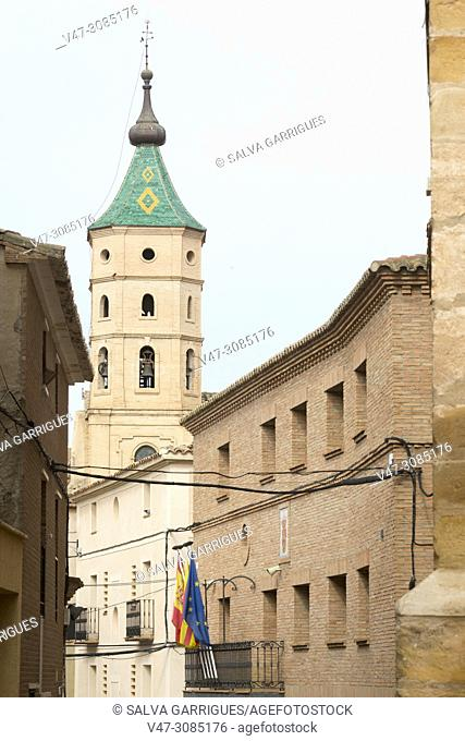 Street of the church with the bell tower and the town hall of Fuendejalon, Aragon, Spain