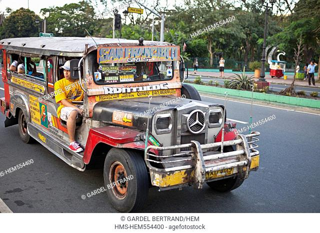 Philippines, Luzon island, Manila, Ermita district, a jeepney jeep extended to carry passengers