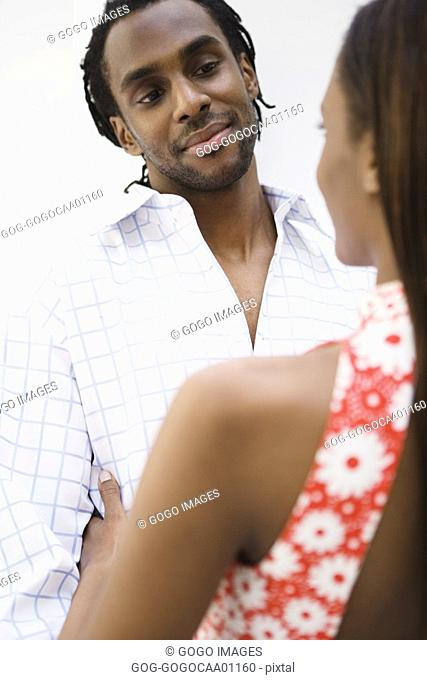 African man smiling at girlfriend