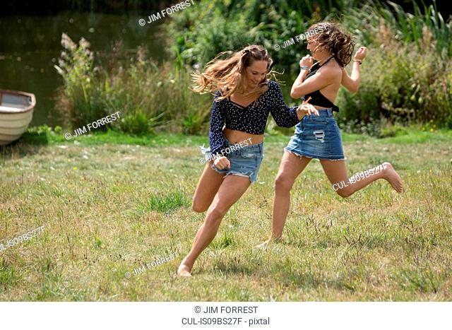 Friends running in park
