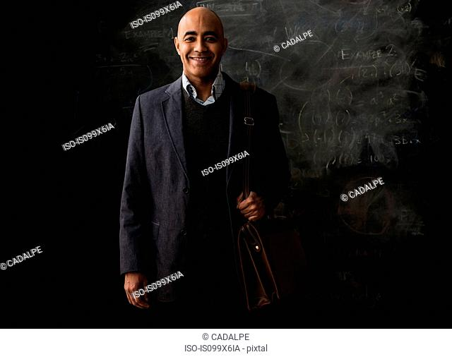 Businessman by blackboard with satchel