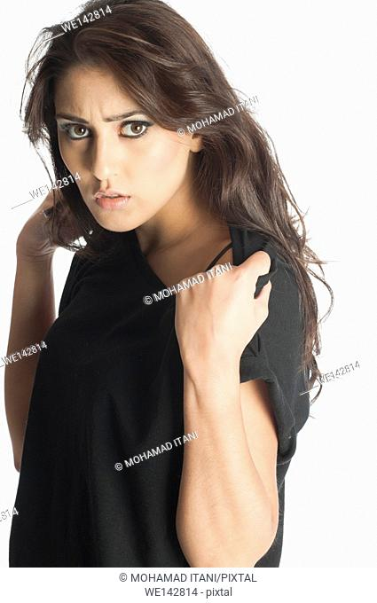 Serious young woman staring