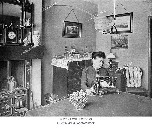 New room in a model dwelling, London, c1900 (1901). Artist: Unknown