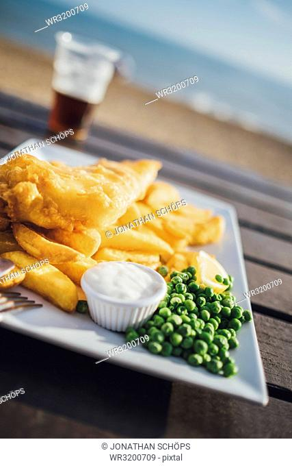 Fish and chips, typical British lunch, restaurant on the beach, Brighton, England