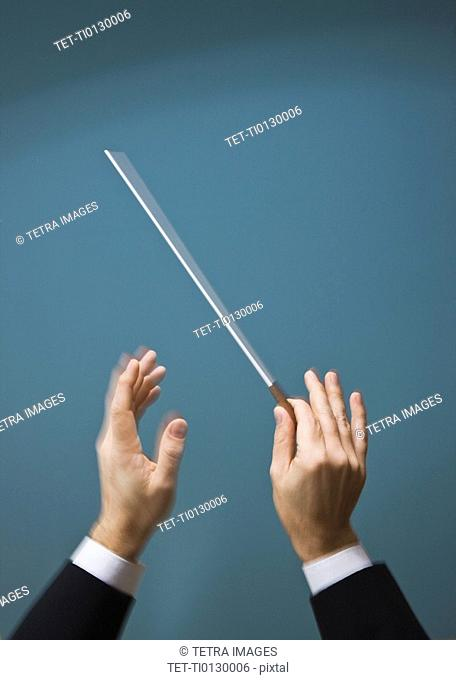Male conductor's hands with baton