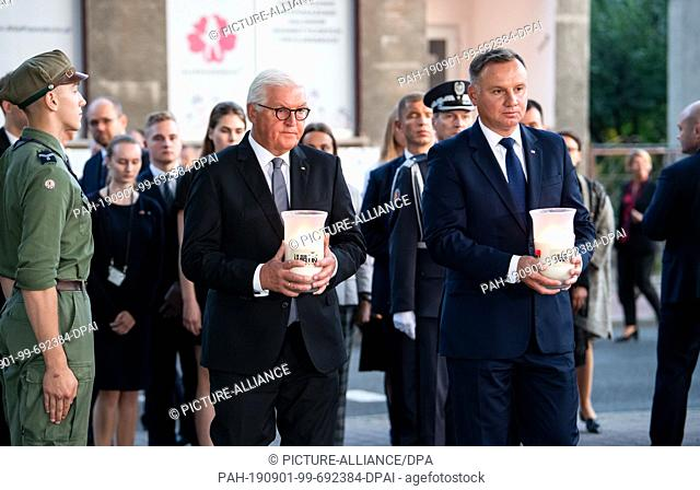 01 September 2019, Poland, Wielun: Federal President Frank-Walter Steinmeier and Polish President Andrzej Duda (r) place candles at the memorial of the...