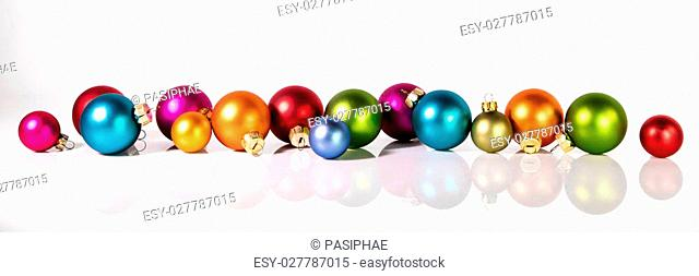 panorama with christmas balls in front of a white background