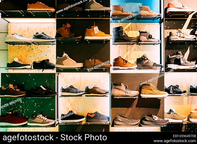 Fashion Casual Male Sneakers On Shelves In Store Of Shopping Center