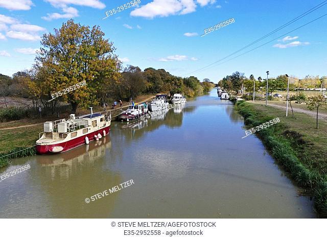 Boats anchored along the Canal du Midi at Capestang, France