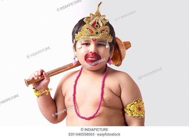 Portrait of boy dressed as God Hanuman against white background
