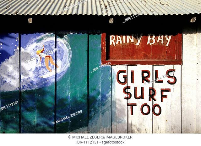 Mural art with a girl surfing, girls surf too, advertisement in La Cahuita, national park, Parque Nacional Cahuita on the Caribbean coast, Caribbean, Costa Rica