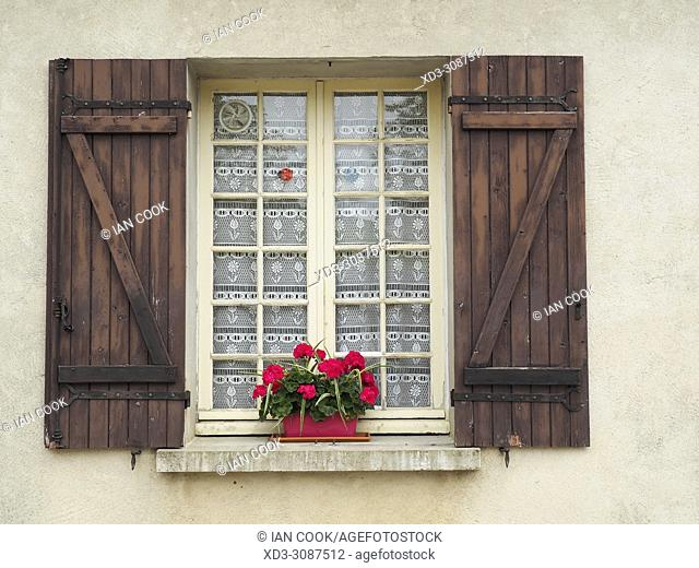 window with flowers, Monpazier, Dordogne Department, Aquitaine, France