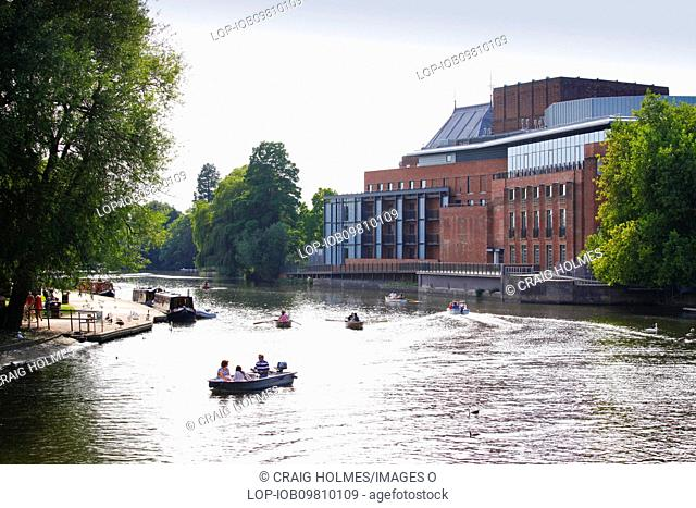 England, Warwickshire, Stratford-upon-Avon. People boating on the River Avon opposite the Royal Shakespeare Theatre RST