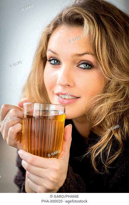 Woman drinking hot beverage