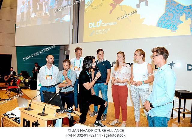 BAYREUTH/GERMANY - JUNE 21: The participants of the Pitch Session are interviewed by Sven Goblirsch (Moderator & Coach) on the stage during the DLD Campus event...