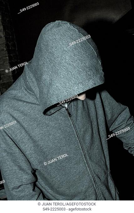 Young man wearing hood jacket, close-up